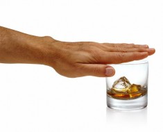 Man Covering Whiskey Glass With Hand --- Image by © Chris Collins/Corbis